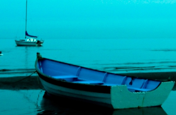 Empty row boat docked at dusk.
